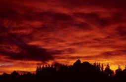 Firey red sunset over the Grand Teton Mountain range in Wyoming made brilliant by the eruption of Mt. Pinatubo in the Phillipines in 1992