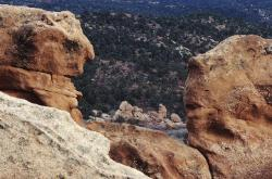 Two rock formations that appear to be faces of people talking to each other in Colorado