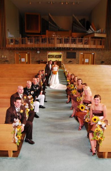 Bridal party in church aisle