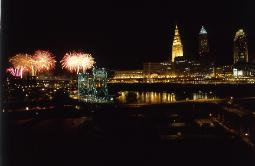Cleveland, Ohio's skyline at night during bicentennial with fireworks in the flats