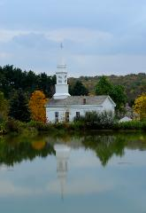 photograph of white steepled church reflected in still waters of a pond at Hale Farm and Village, Ohio