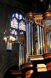 photograph of the stained glass window, chandalier and large pipe organ (all in one photo) from inside Trinity Cathedral, Cleveland, Ohio