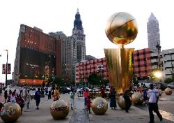 Photo of LeBron James' Nike billboard and Cleveland, Ohio's city buildings with The Finals giant trophy in front of Quicken Loans Arena