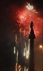 The Soldier's and Sailor's Monument on Cleveland, Ohio's Pulblic Square with fireworks behnid it